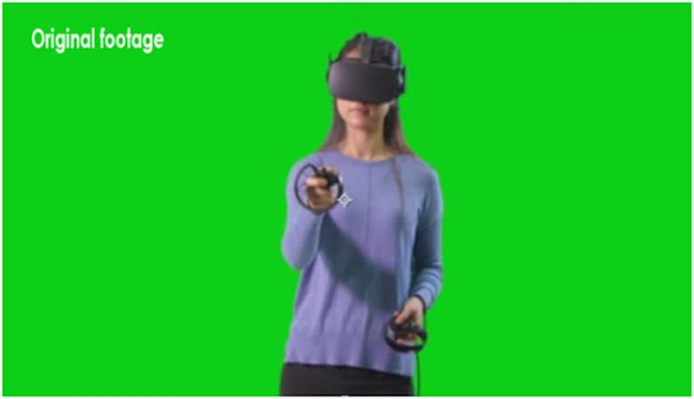 Woman playing vr on green screen